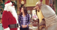 """385848 20: Actors (l-r): Matthew Perry as Chandler Bing, Courteney Cox Arquette as Monica Geller and David Schwimmer as Ross Geller star in NBC's comedy series """"Friends."""" Episode: """"The One with the Holiday Armadillo."""" IN THIS CORNER, HAILING FROM THE NORTH POLE SANTA CLAUS. IN THIS CORNER, HAILING FROM TEXAS THE HOLIDAY ARMADILLO. (Photo by Warner Bros. Television)"""